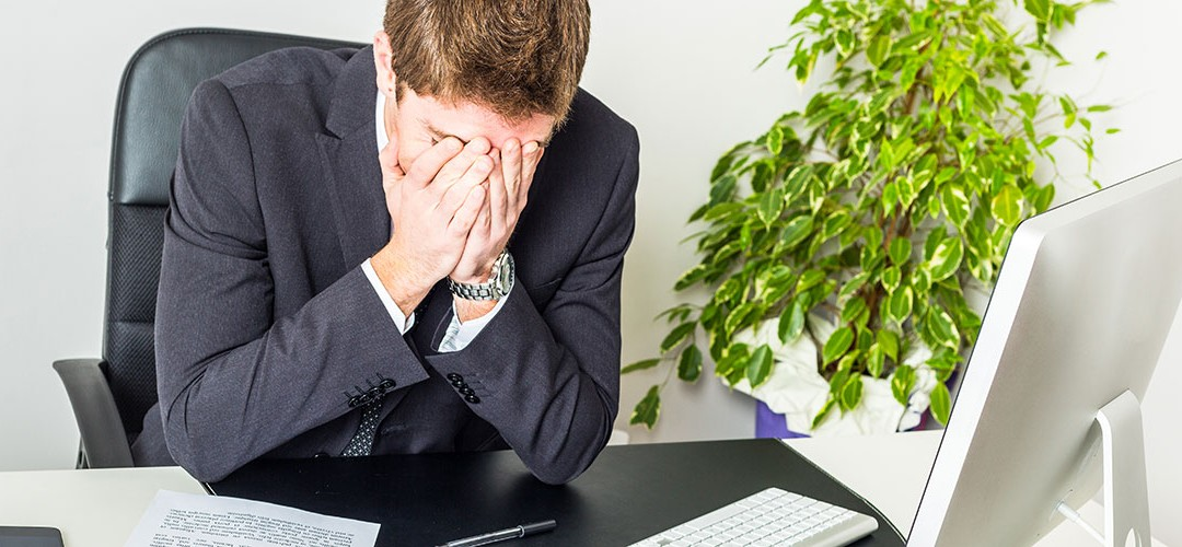 Stressed businessman. 3 ways positive psychology can reduce absenteeism