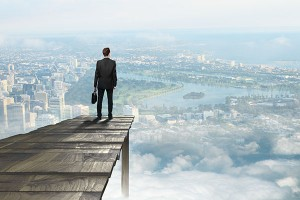 Business man looking at city. 3 ways positive psychology will keep you motivated at work